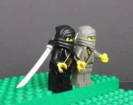 Lego 2 Ninja Warriors & Katanas Minifigs 1 Black 1 Grey - $17.50