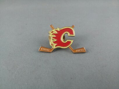 Primary image for Calgary Flames Pin - Featuring Team Logo between 2 Hockey Sticks