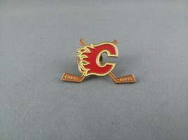 Calgary Flames Pin - Featuring Team Logo between 2 Hockey Sticks  - $15.00