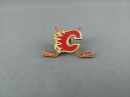 Calgary Flames Pin - Featuring Team Logo between 2 Hockey Sticks  - $15.00