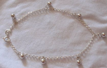 Seven rounds silver anklet