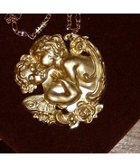 lovers in brass pendant 2 inch diameter on a 19... - $19.99