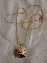 beautiful gold tone sand dollar pendant and chain - $4.95