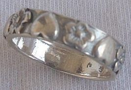 Herats and flowers silver ring - $15.00