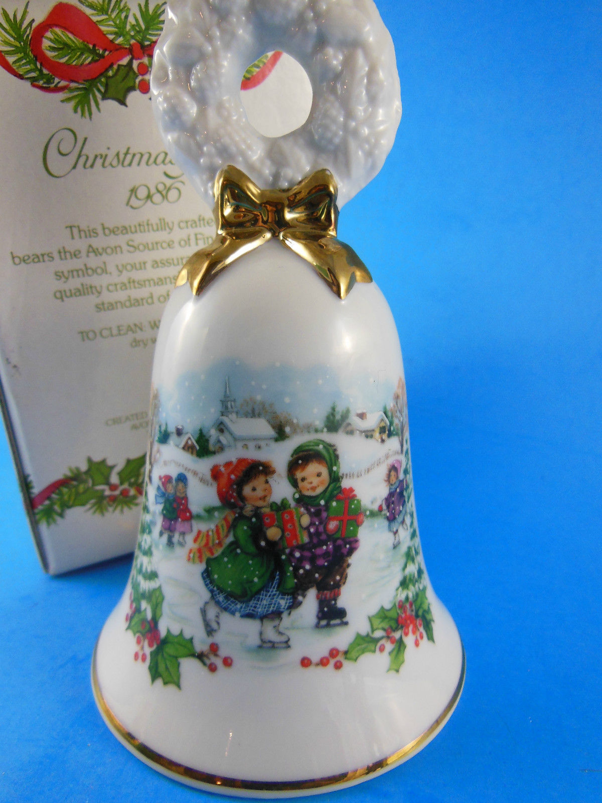 AVON 1986 Porcelain Christmas Bell Children ice skating Winter scene - $8.41
