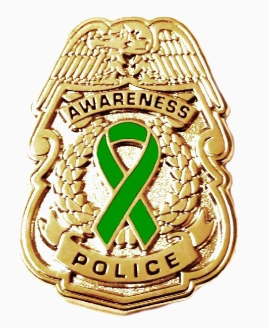 Primary image for Green Awareness Ribbon Pin Police Badge Security Sheriff Cancer Causes Gold New