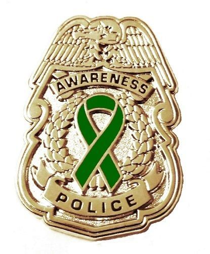 Primary image for Green Awareness Ribbon Pin Police Badge Security Sheriff Cancer Silver New