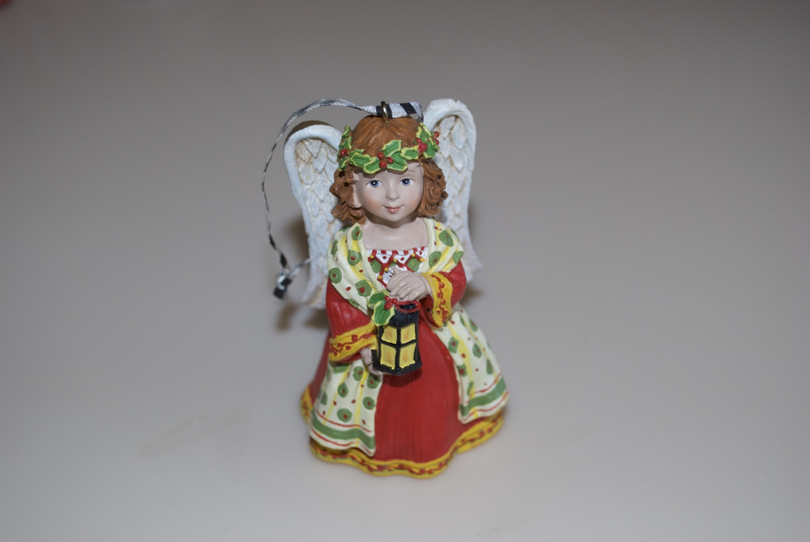Mary Engelbreit Christmas Angel with Lantern Red Yellow Green Ornament