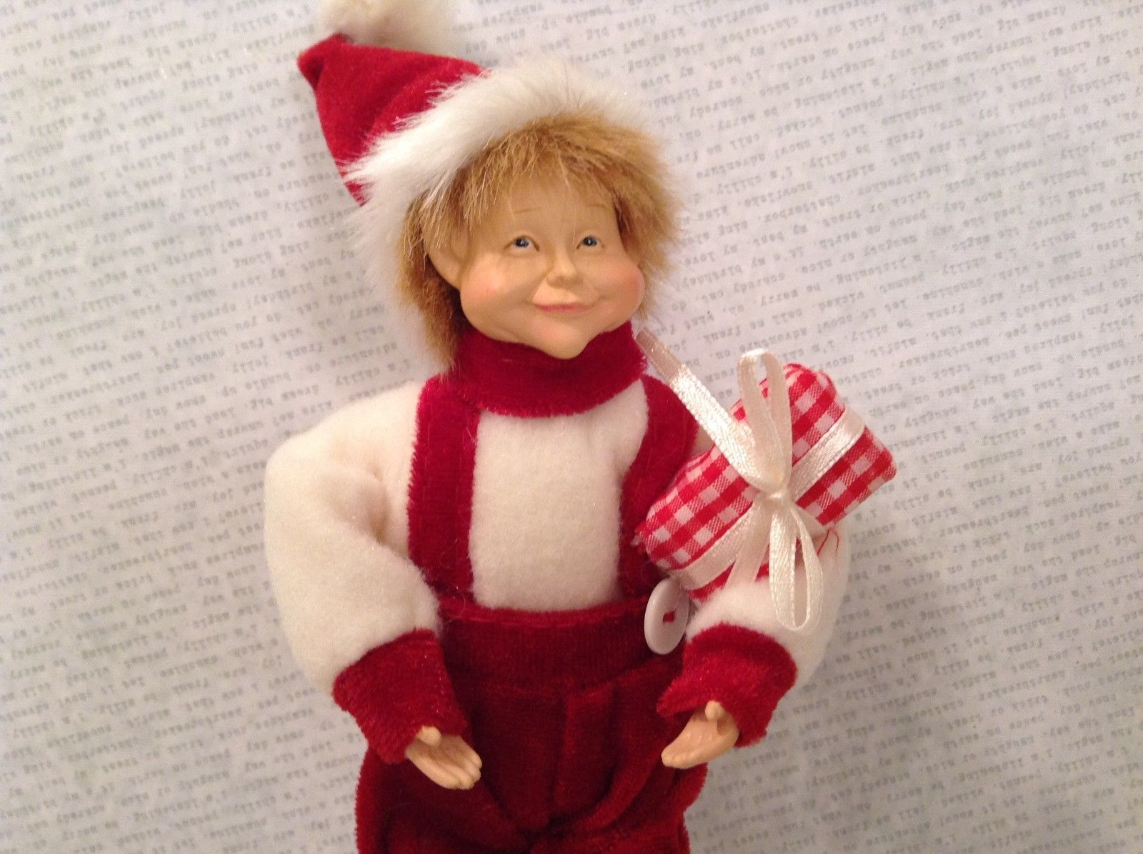 Charming detailed elf red and white candy stripes with present ornament