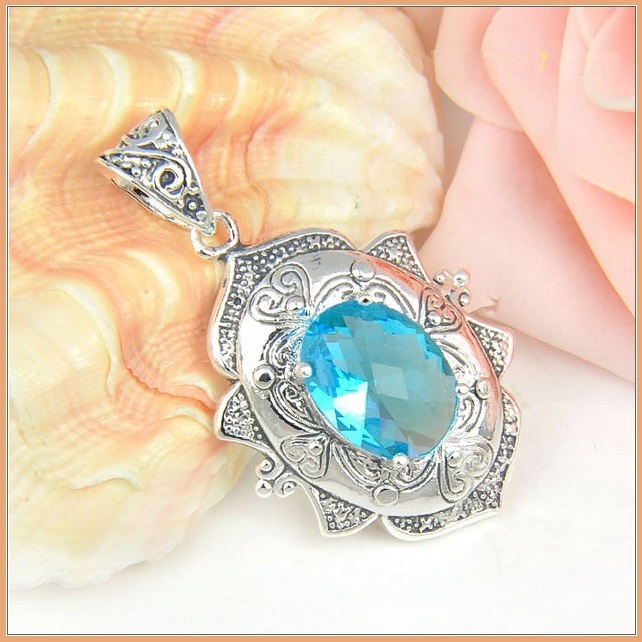 Sterling Silver Vintage Artisian Hand Crafted Oval Sky Topaz Blue Pendant