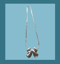Sterling Silver Bow Pendant and 18 Inch Snake Style Chain Necklace - $25.99
