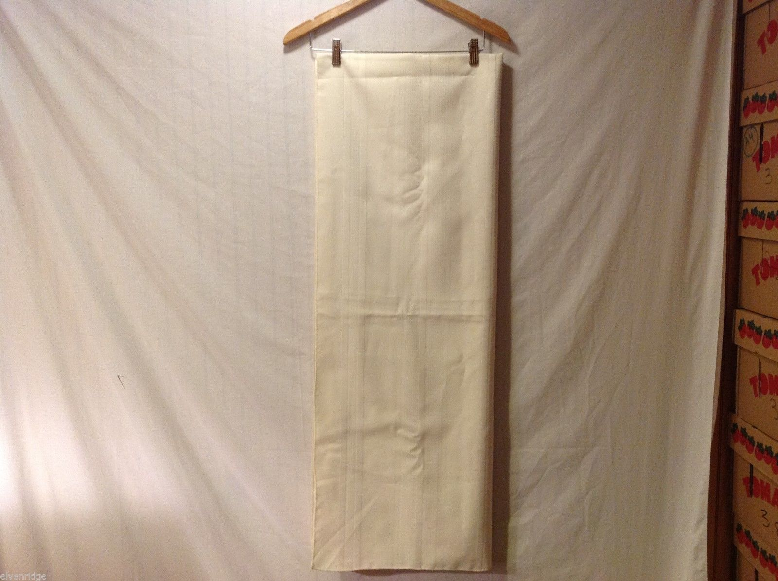 "84"" Rectangle cream colored tablecloth"