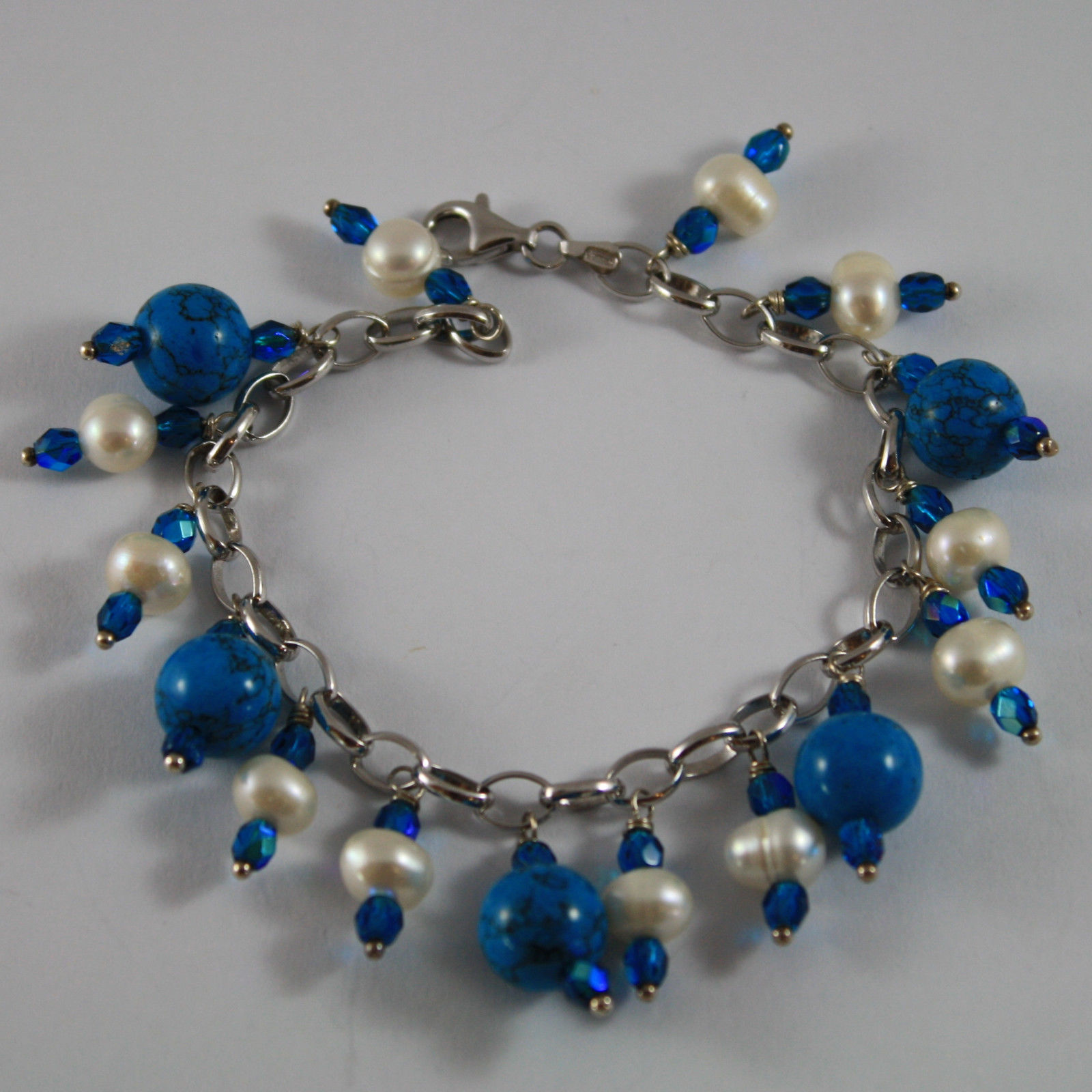.925 RHODIUM SILVER BRACELET WITH BLUE CRYSTALS,WHITE PEARLS AND TURQUOISE