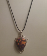 Genuine Jasper Stone Pendant On Black Cord - $10.99