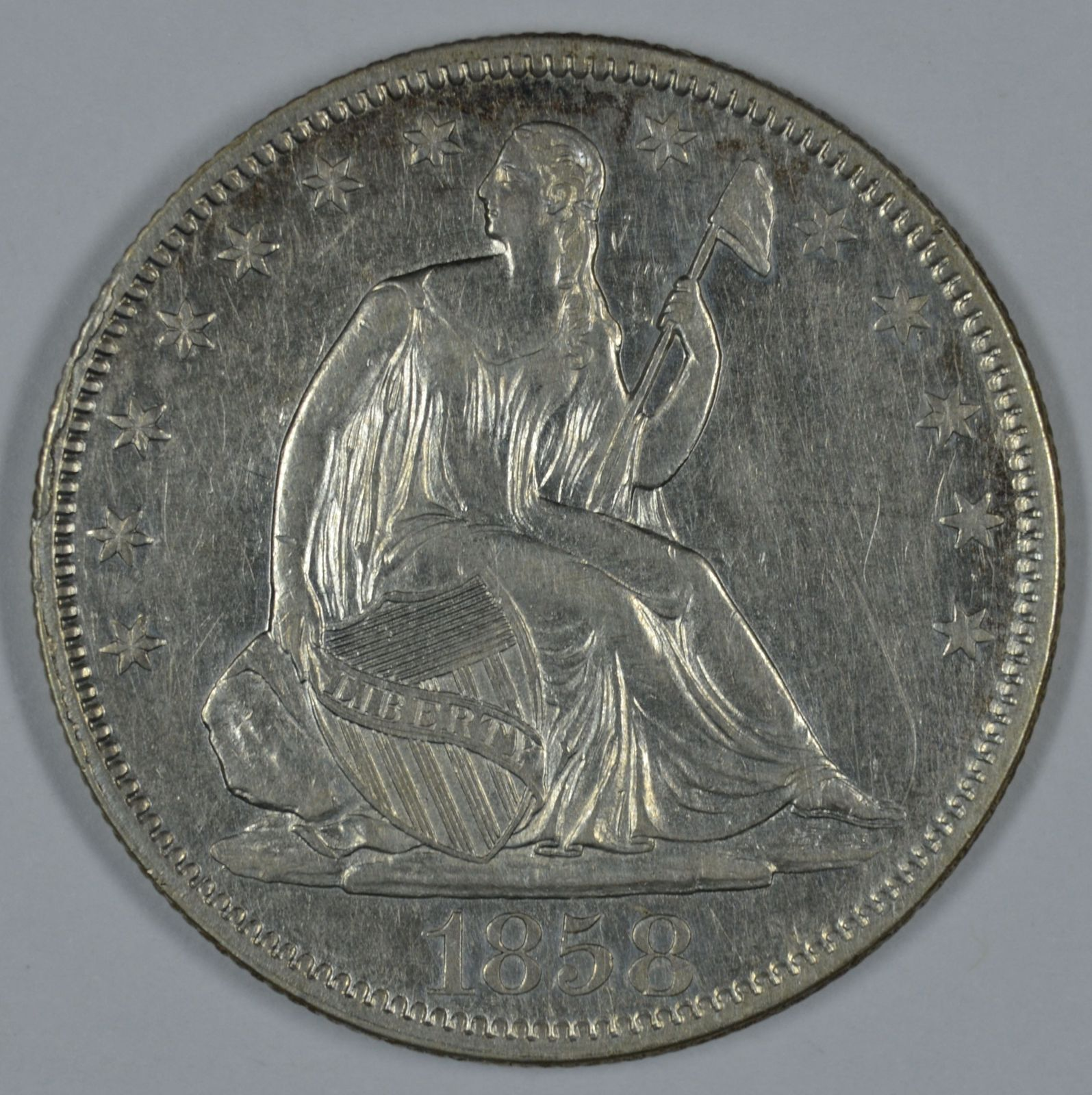 Primary image for 1858 Seated Liberty circulated silver half dollar VF+ details Rim Cud on obverse