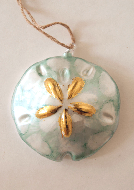 Primary image for Pottery Barn sand dollar glass Christmas ornament blue and gold