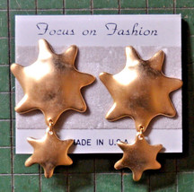 nos new vintage large sun star metal clip earrings dangle drop long - $7.91
