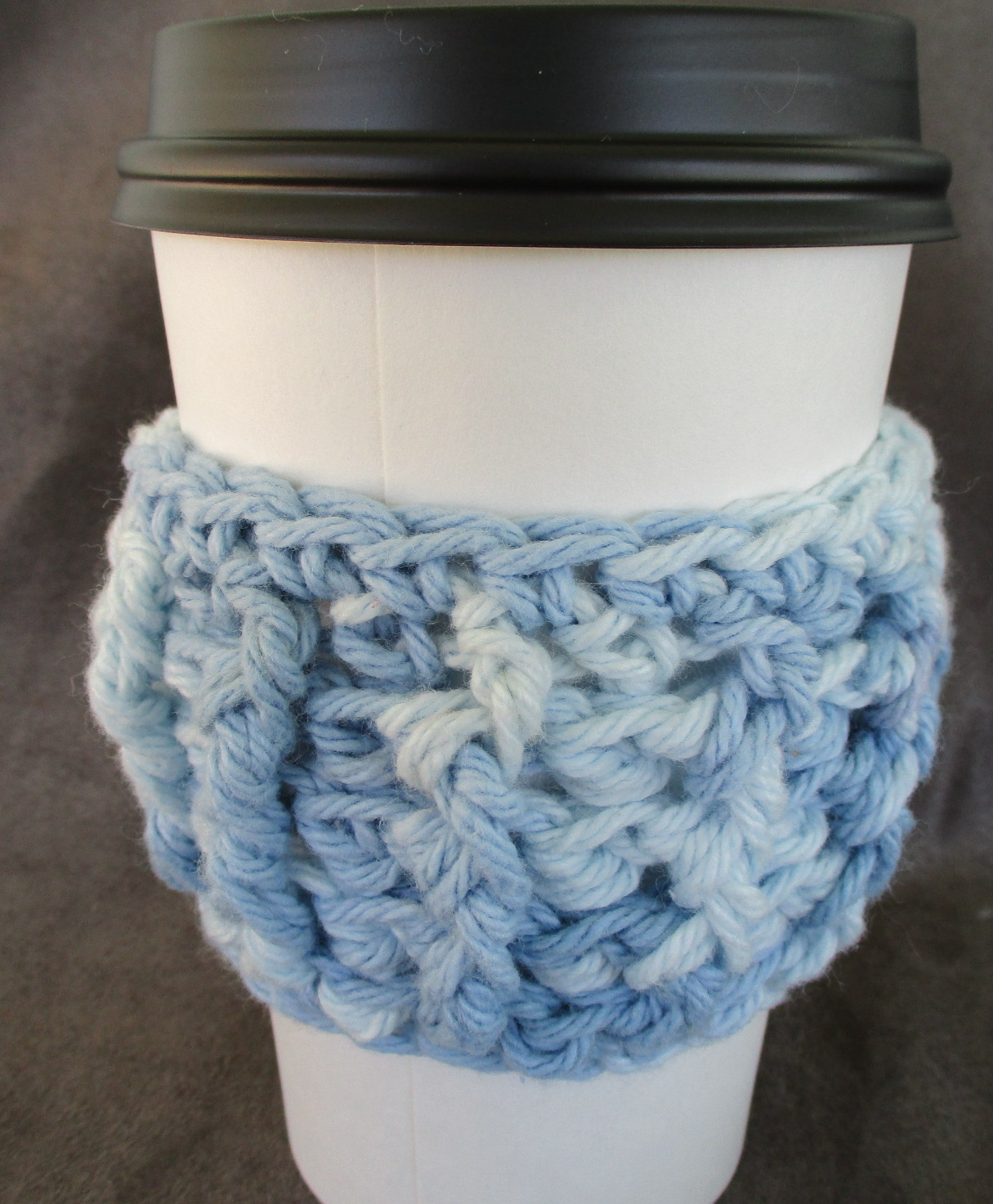 To Go Cup Cozy Sleeve in shades of blue with ceramic watering can shape button