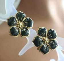 "Elegant Black Enamel Gold-tone Flower Clip Earrings 1970s vintage 7/8"" - $12.30"