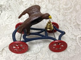 Colorful, Eagle Cast Iron Pull Toy,  8in L x 5in W 6in H - $56.95