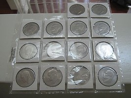 Eisenhower Dollar , Lot of 7 , 1976 , AU / Un Circ. - $20.00