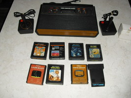 Atari 2600 4 SWITCH with joysticks, adapter, 8 GAMES  laser blast, lock n chase - $148.49