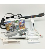Nintendo Wii Bundle w/ 5 games, 2 Controllers, 1 Guitar, Super Mario vid... - $154.26