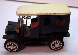 Toy model A sedan, Pressed steel, 6 inches by 4 inches - $15.00