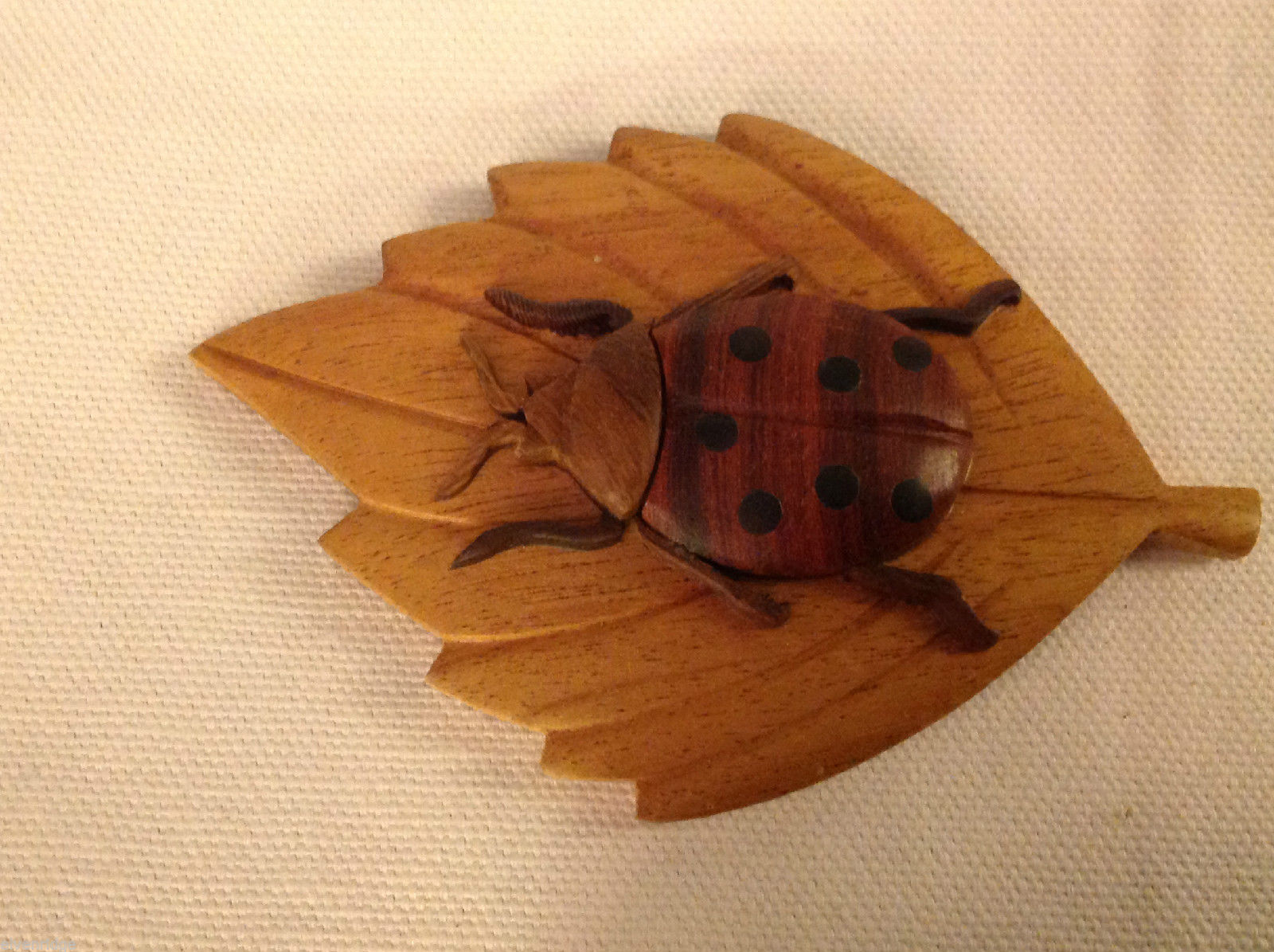 Hand carved wood ladybug on leaf  Refrigerator or other surface magnet