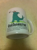 GOLFASAURUS--COFFEE MUG / CUP--LINKS LOVING CREATURE--GOLF---FREE SHIP--NEW - $267,45 MXN