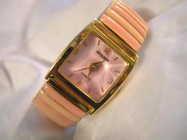 L31, Gossip,  Ladies Pink Domed Peak Faced Watch, Light Pink Flex Band  w/b - $19.79