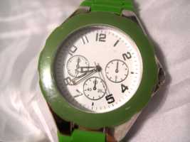 "L55, Ladies White Faced Watch, Silver Tone, 9"" Green Silicon Band, w/b - $11.79"
