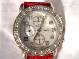 "L09, Ladies Watch, Crystals, Mother of Pearl Face, 8"" Red Band  w/b - $15.83"