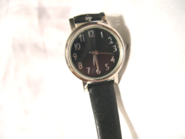 "L25, Ladies Black Faced Watch, Silver Tone, 8"" Black Band  w/b - $11.87"