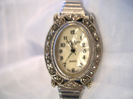 L11, La Express, Oval Pearly Face Surrounded by Crystals, Flex Band w/b - $15.79