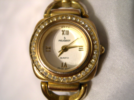 "L10, Peugeot, Ladies 7"" Gold Tone Bracelet Watch, Crystals, White Face - $12.79"