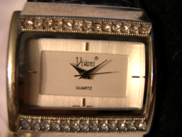 "L14, Vivani, Ladies Watch, Crystals on Leather Cuff Band, 2"" inner dia. - $12.87"