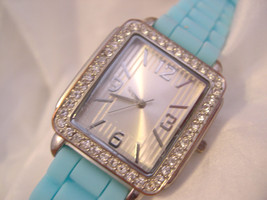 """L69, Ladies Silver Faced Wristwatch, Rhinestones, 9"""" Turquoise Silicon Band, w/b - $11.99"""