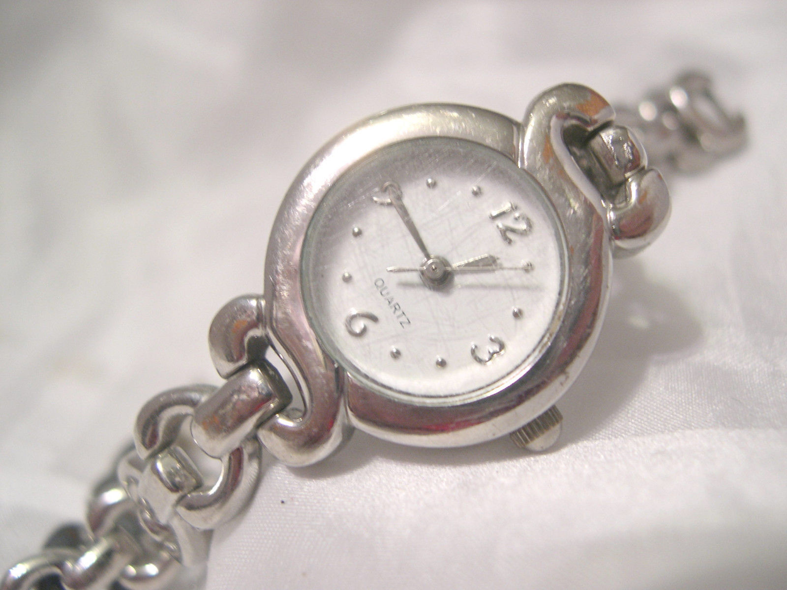 "Primary image for L67, Ladies 7"" Silver Tone Bracelet Watch,  Round White Face  w/b"