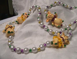 """mardi grass Four Ceramic Little Pigs - with Faux Pearls and Beads - 36"""" - $5.93"""