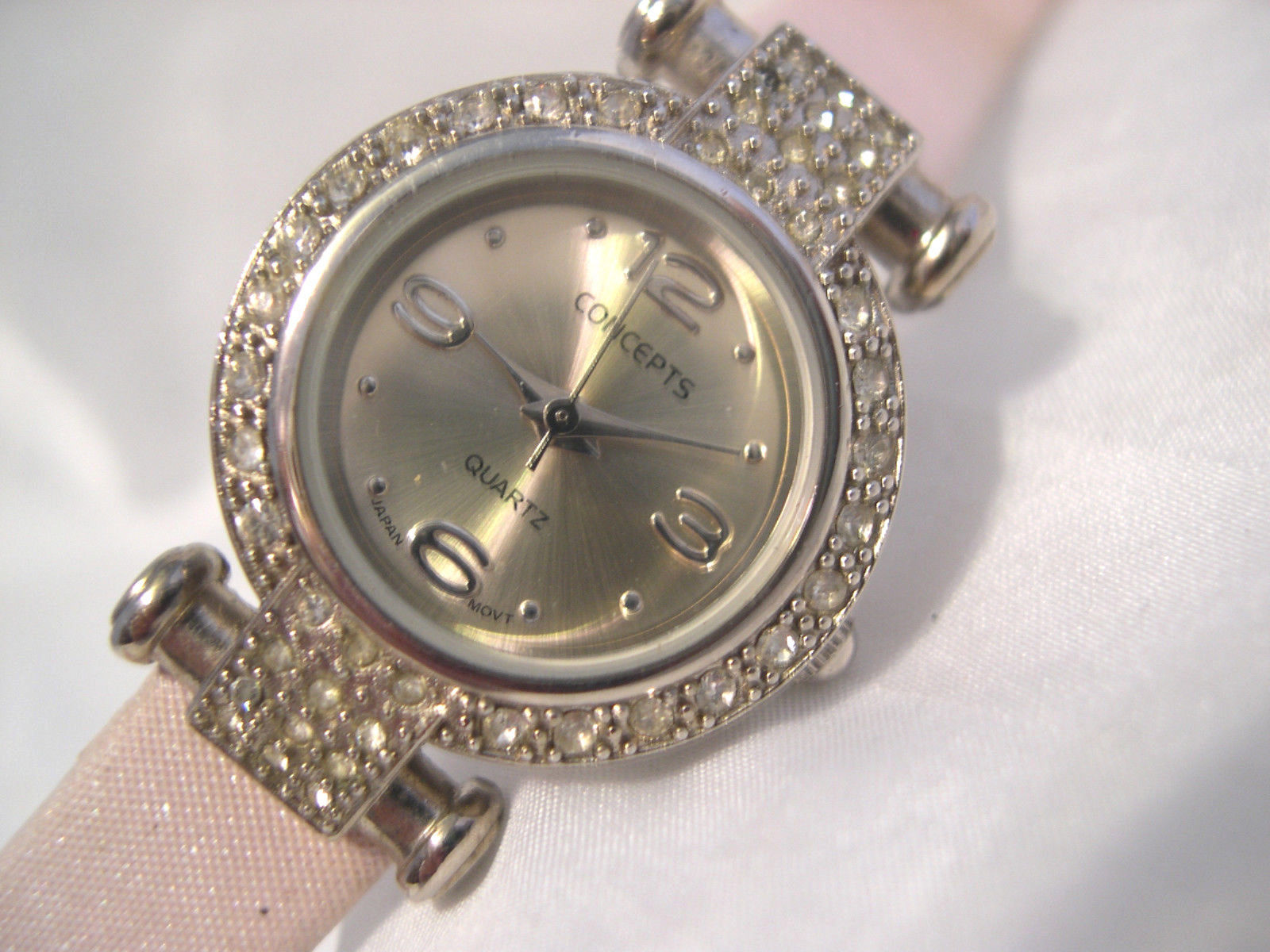 "L62, Concepts in Time, NY, Ladies Silver Tone Watch, Crystals, 8"" Pink Band w/b - $19.83"