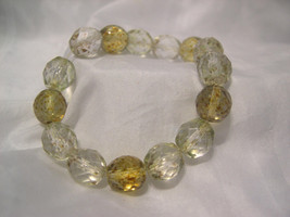 B08, Clear and Gold Faceted Beads on Stretch Bracelet - $3.95