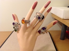 Collection of Eight Various Colored Silver Rings