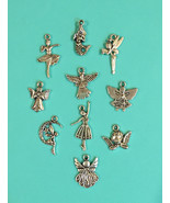10 pieces Mixed Tibetan Silver Plated  Charm Gi... - $2.20