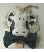Cow_face_with_green_bow_thumbtall