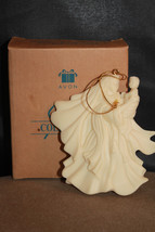 Avon 1997 Gift Collection Mary and Baby Cast Resin Christmas Ornament - $11.88
