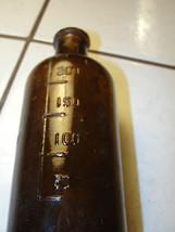 Vintage brown medicine bottle, old, embossed nu... - $56.15