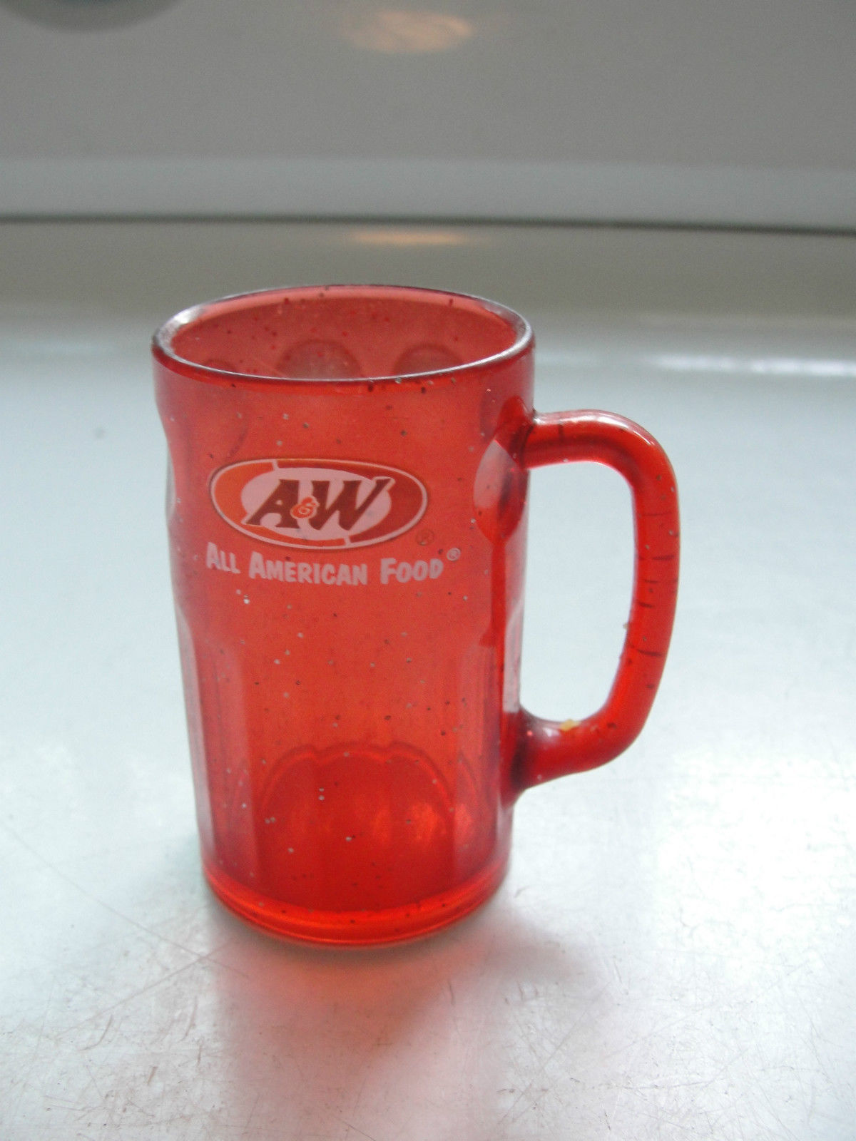 Miniature A & W red sparkle plastic mug, advertising
