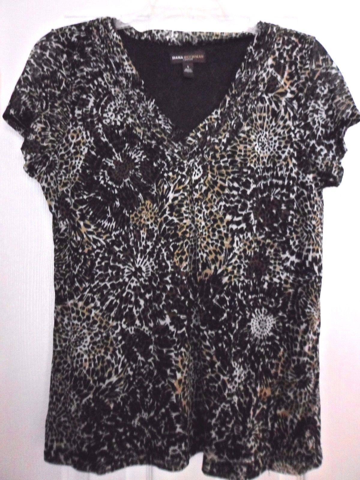 8fe134654b07c S l1600. S l1600. Previous. Dana Buckman Women s Short Sleeve V Neck Animal  Print Blouse L Large