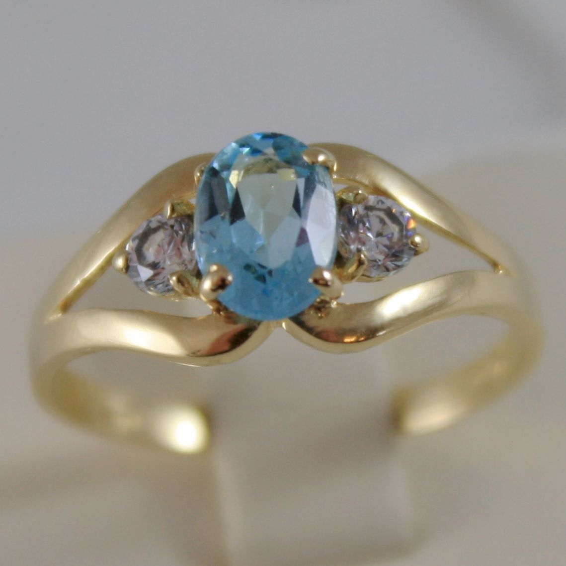 SOLID 18K YELLOW GOLD RING WITH OVAL BLUE TOPAZ AND ROUND ZIRCONIA MADE IN ITALY